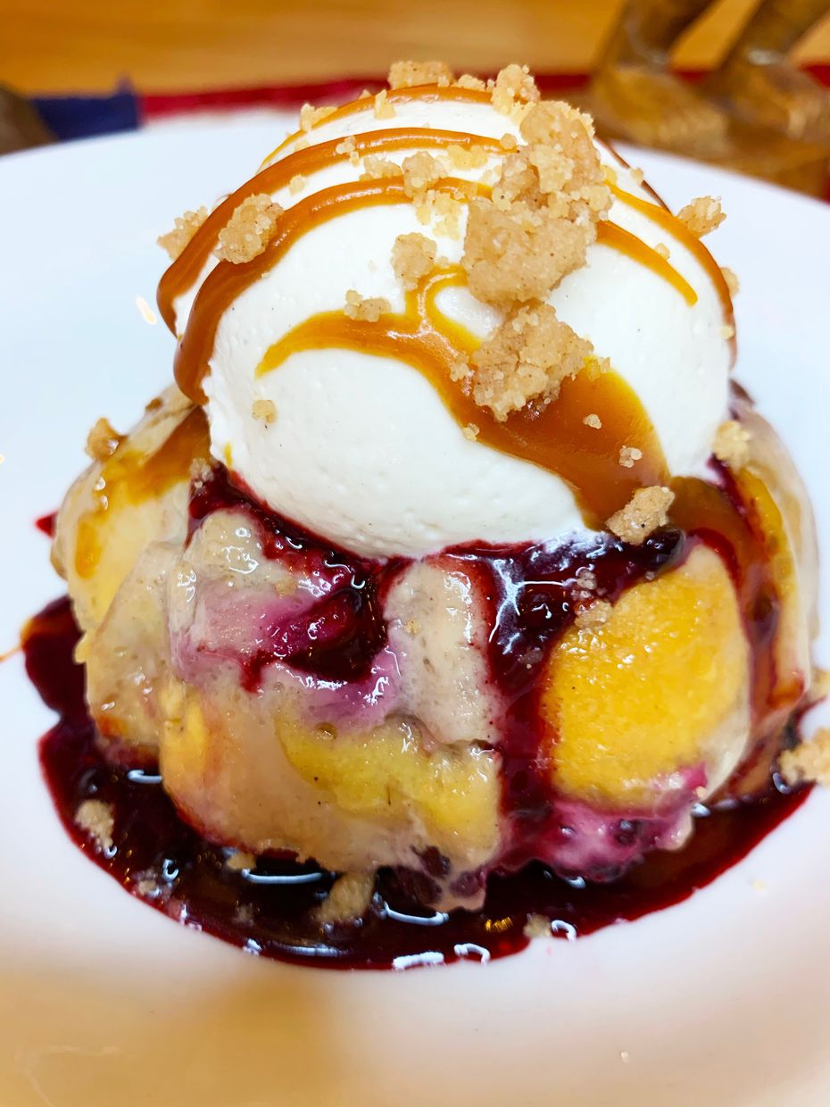 Blackberry bread pudding comes topped with salted caramel drizzle.
