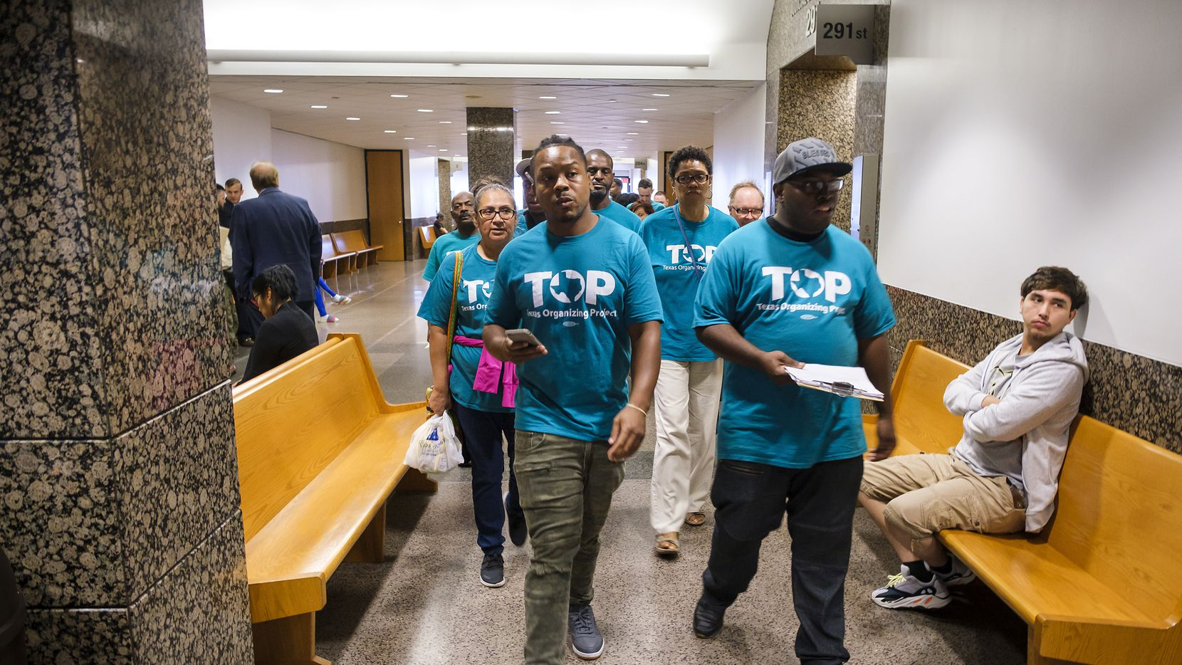 A group of Texas Organizing Project (TOP) representatives visit Dallas County felony court judges at the Frank Crowley Courts Building on Thursday, Oct. 10, 2019, in Dallas. In September 2018, a federal judge ruled against the Dallas County bail system in a lawsuit, stating that the countyÕs bail practices violated people's constitutional rights. Texas Organizing Project Education Fund is a plaintiff in the lawsuit. (Smiley N. Pool/The Dallas Morning News)