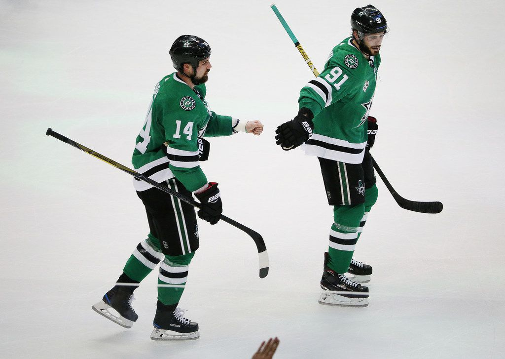 Dallas Stars left wing Jamie Benn (14) is congratulated by center Tyler Seguin (91) after Benn scored on the power play to make the score 1-1 in the first period during a National Hockey League game between the Washington Capitals and the Dallas Stars at the American Airlines Center in Dallas Tuesday December 19, 2017. The game was tied 1-1 after the first period. (Andy Jacobsohn/The Dallas Morning News)