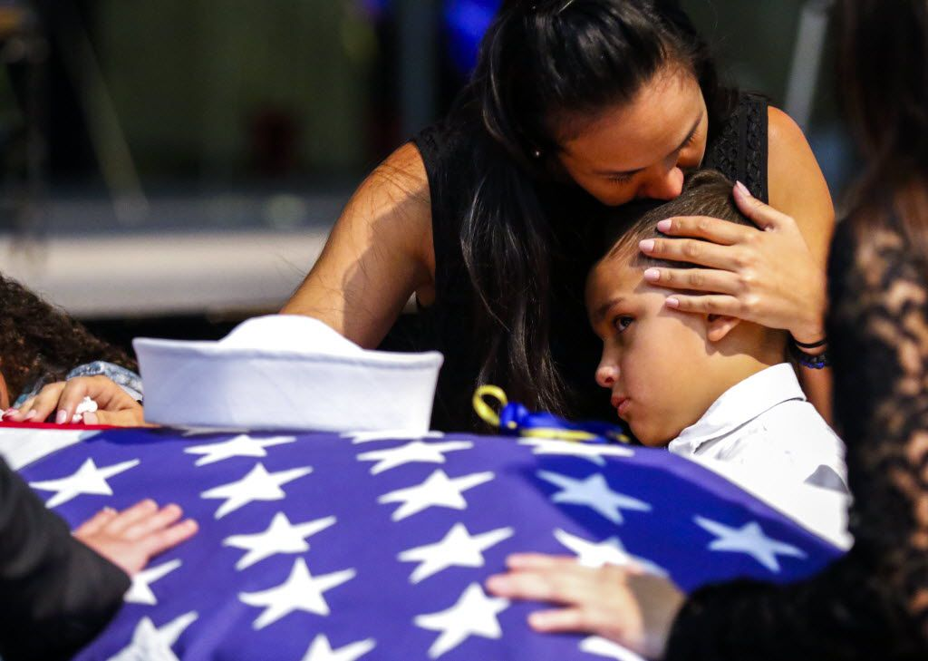 Kristy Villasenor, girlfriend of Dallas police officer Patrick Zamarripa, shares a moment with her son, Dylan, after a funeral service for Zamarripa on Saturday.