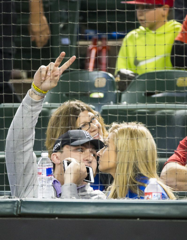 Johnny Manziel waves to the crowd as he watches from the seats behind home plate as the Texas Rangers face the Los Angeles Angels at Globe Life Park on Tuesday, April 14, 2015, in Arlington. (Smiley N. Pool/The Dallas Morning News) [ 2015PUB - 2015APRIL ] 04152015xSPORTS