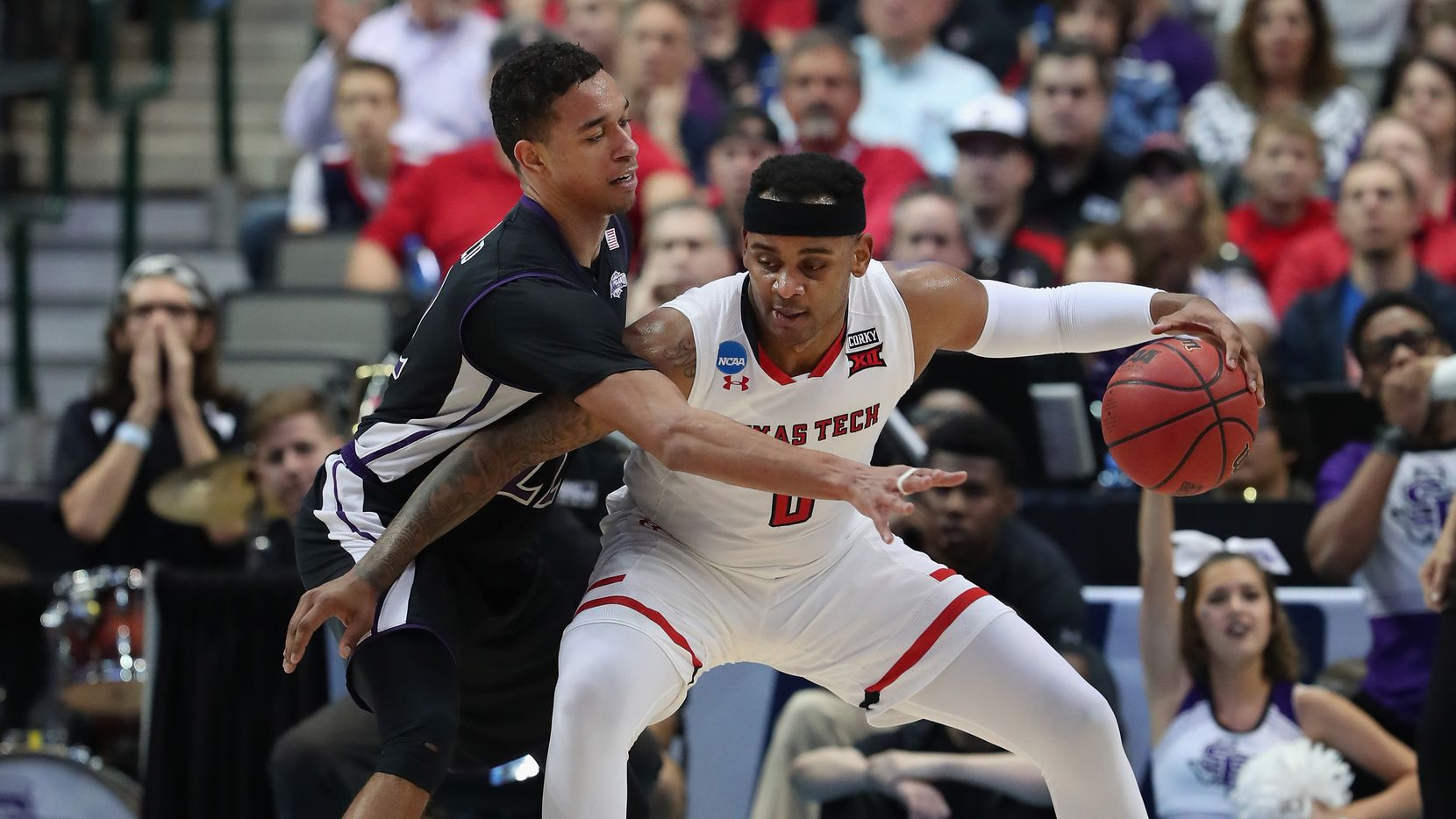 DALLAS, TX - MARCH 15:  Tommy Hamilton IV #0 of the Texas Tech Red Raiders drives against TJ Holyfield #22 of the Stephen F. Austin Lumberjacks  in the first half in the first round of the 2018 NCAA Men's Basketball Tournament at American Airlines Center on March 15, 2018 in Dallas, Texas.  (Photo by Tom Pennington/Getty Images)