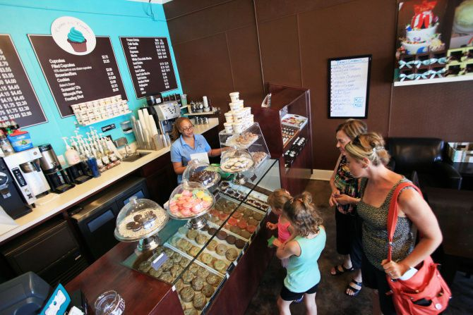 The McCormick family checked out the treats recently at Crème de la Cookie at Snider Plaza in Dallas. The store sells cupcakes, cookies and other goodies.