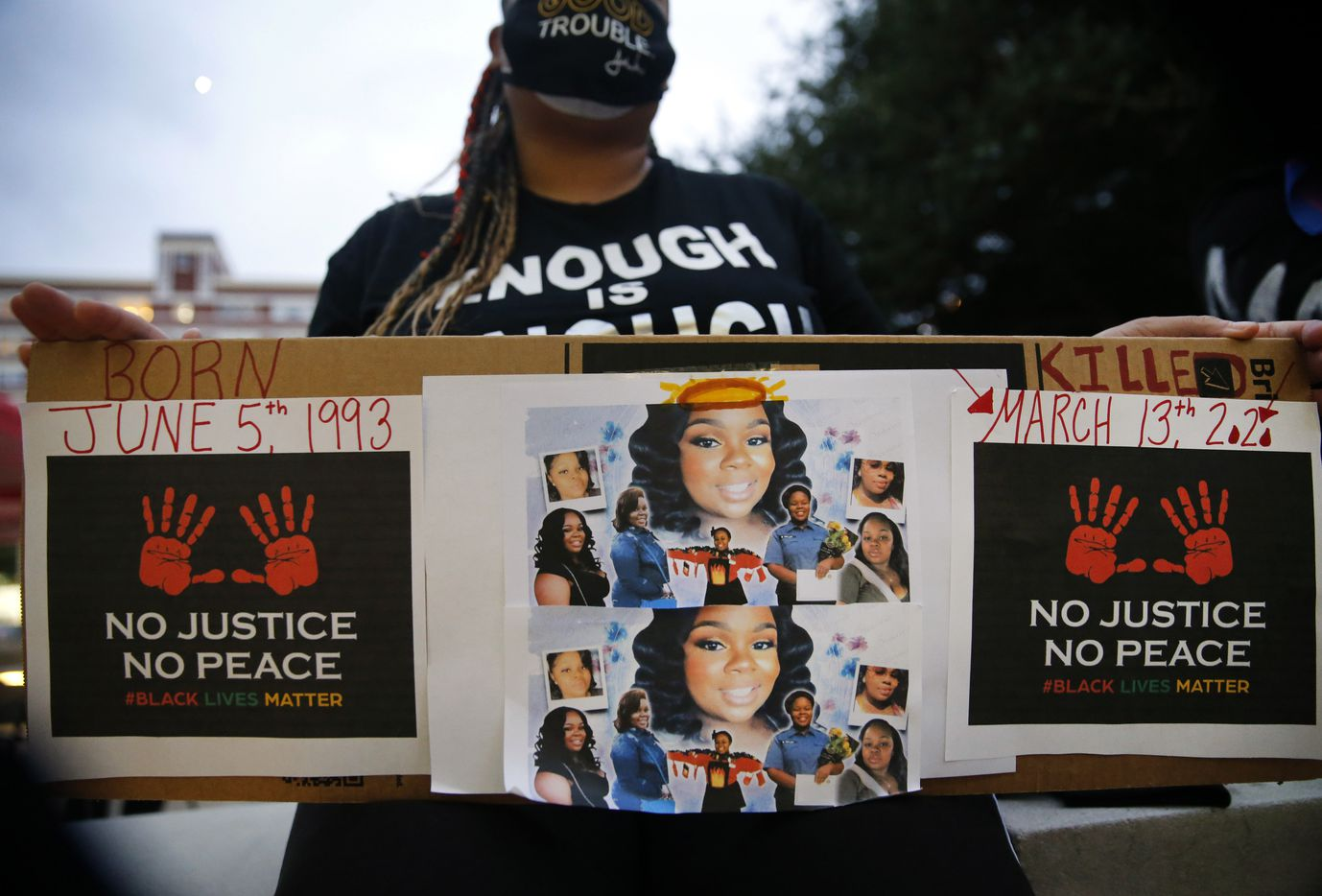 Shena Lee of Dallas displayed photos of Breonna Taylor during a Next Generation Action Network protest outside of Dallas Police Headquarters before they marched down S. Lamar St. in Dallas, Wednesday, September 23, 2020. A Kentucky grand jury brought no charges against the Louisville police for the killing of Taylor during a drug raid gone wrong. (Tom Fox/The Dallas Morning News)