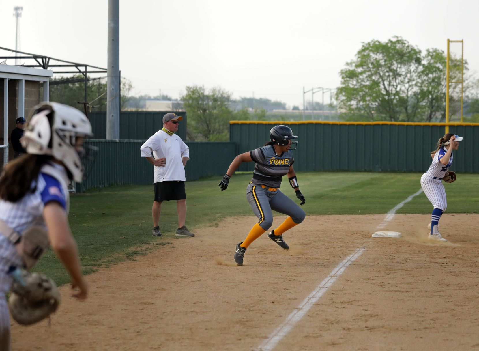 Vanessa Hollingsworth attempts to return to third base during a softball game between Forney at North Forney at North Forney High School in Forney, TX, on Apr. 9, 2021. (Jason Janik/Special Contributor)