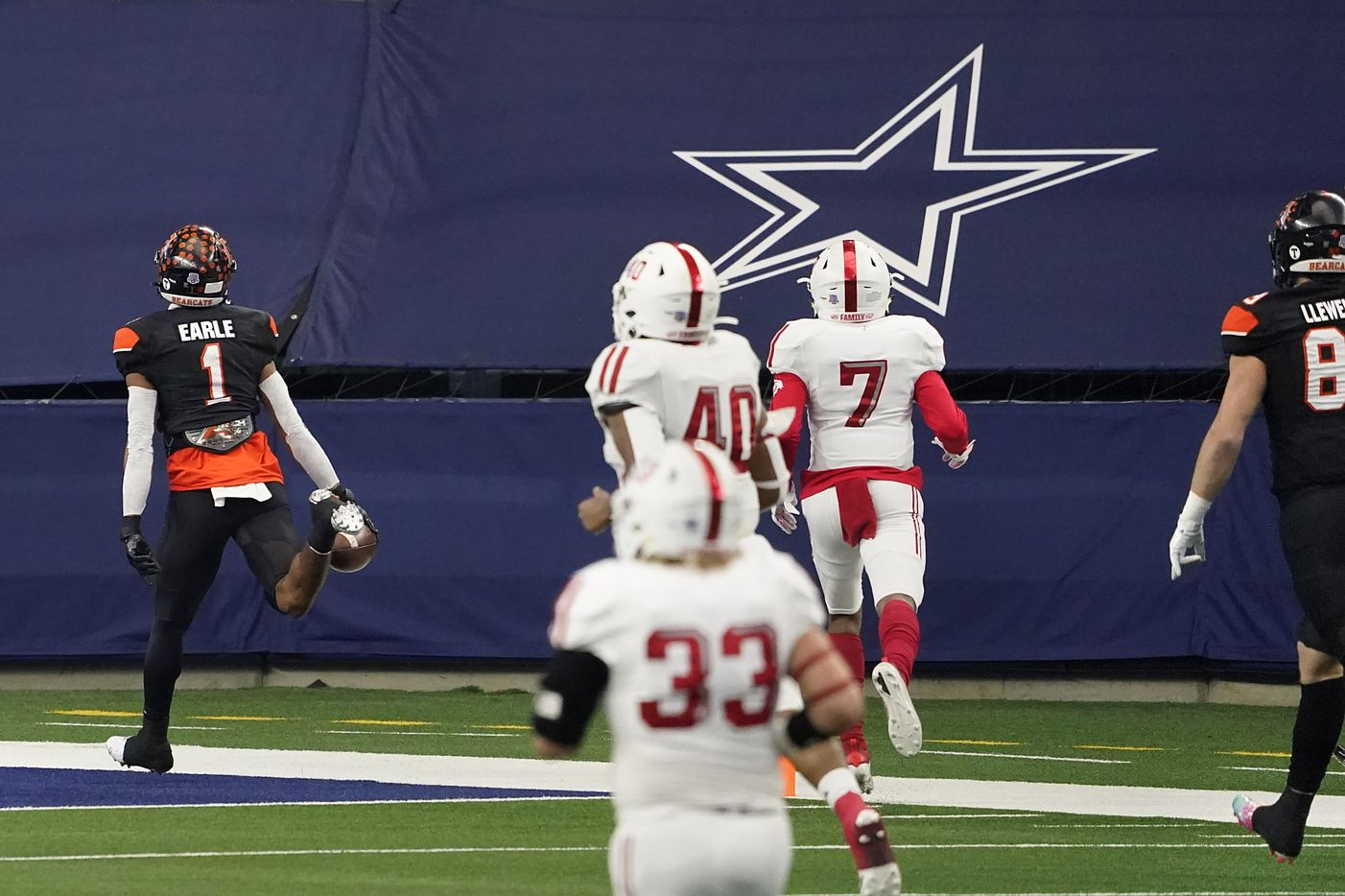 Aledo JoJo Earle (1) races through the Crosby defense on a 74-yard touchdown during the first half of the Class 5A Division II state football championship game at AT&T Stadium on Friday, Jan. 15, 2021, in Arlington. (Smiley N. Pool/The Dallas Morning News)