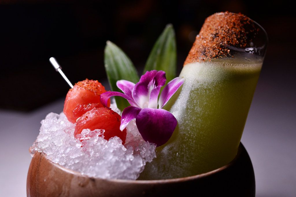 The El Peje — essentially a spiced-up cucumber margarita — is served with El Tesoro tequila, cucumber, serrano syrup, lime and orange liqueur at La Viuda Negra. a new speakeasy-style bar in Dallas.