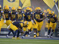 McKinney players run onto the field before a high school football game between Plano and McKinney, Friday, Sept, 25 2020, in McKinney, Texas. (Matt Strasen/Special Contributor)