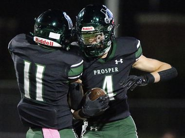 Prosper High School wide receiver Houston Hawkins (4) celebrates with Prosper High School team mate Noah Billings (11) after Hawkins scored a touchdown during the first half as Prosper High School hosted Denton Guyer High School in a District 5-6A football game at Children's Health Stadium in Prosper on Friday night, October 30, 2020.