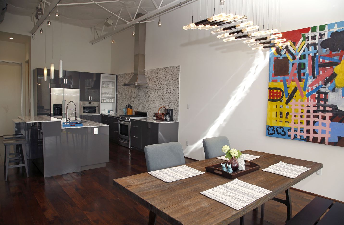 The kitchen and dining area in one of the Vantage Street loft homes in Dallas' Design District.