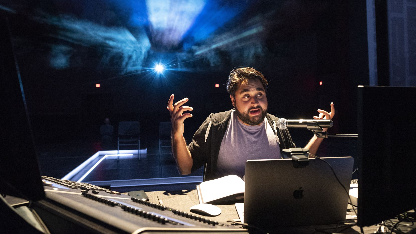 """Ruben Carrazana in """"The Cube,"""" which he wrote, directed and co-conceived earlier this year. Carrazana has since become one of four playwrights commissioned  by Kitchen Dog Theater to write a play for its 2021 New Works Festival. Writer and producer Ruben Carrazana, center, has his image projected on a wall, not pictured, as he speaks during a rehearsal of The Cube: An Interactive Experience For The Socially Distanced Era, takes placewith on Friday, Jan. 15, 2021 at the Latino Cultural Center in Dallas."""