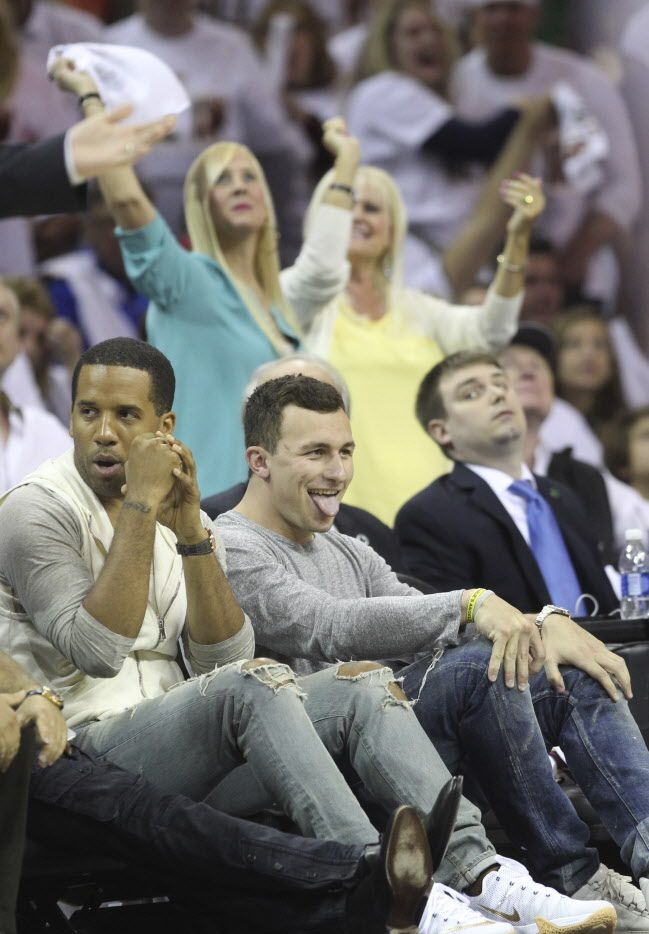 Cleveland Browns quarterback Johnny Manziel reacts after Cleveland Cavaliers' LeBron James dunks during the first half against the Boston Celtics on Sunday, April 19, 2015, at Quicken Loans Arena in Cleveland, Ohio. (Phil Masturzo/Akron Beacon Journal/TNS)