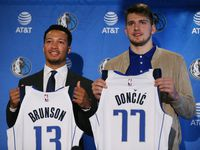 Mavericks players Jalen Brunson (left) and Luka Doncic are introduced at American Airlines Center in Dallas Friday June 22, 2018.
