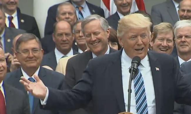 Rep. Michael Burgess (left) behind the president at a White House celebration over the House vote to repeal the Affordable Care Act.