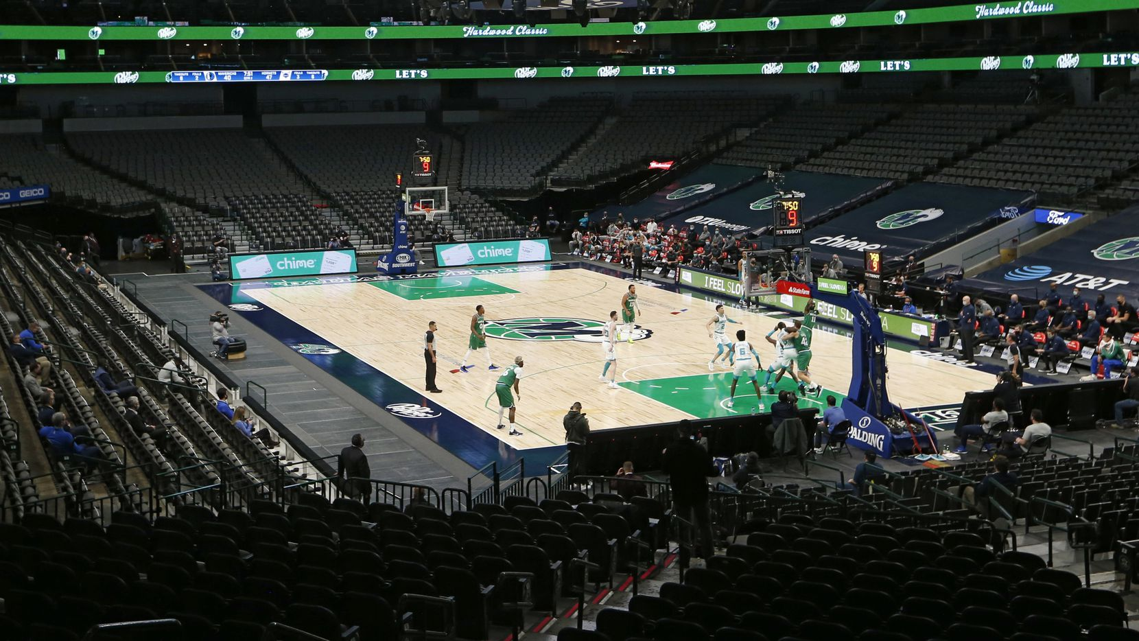 The Dallas Mavericks and Charlotte Hornets tip off as they play in the second quarter of play of the home opener at American Airlines Center on Wednesday, December 30, 2020 in Dallas. No fans were allowed in the arena for the game.