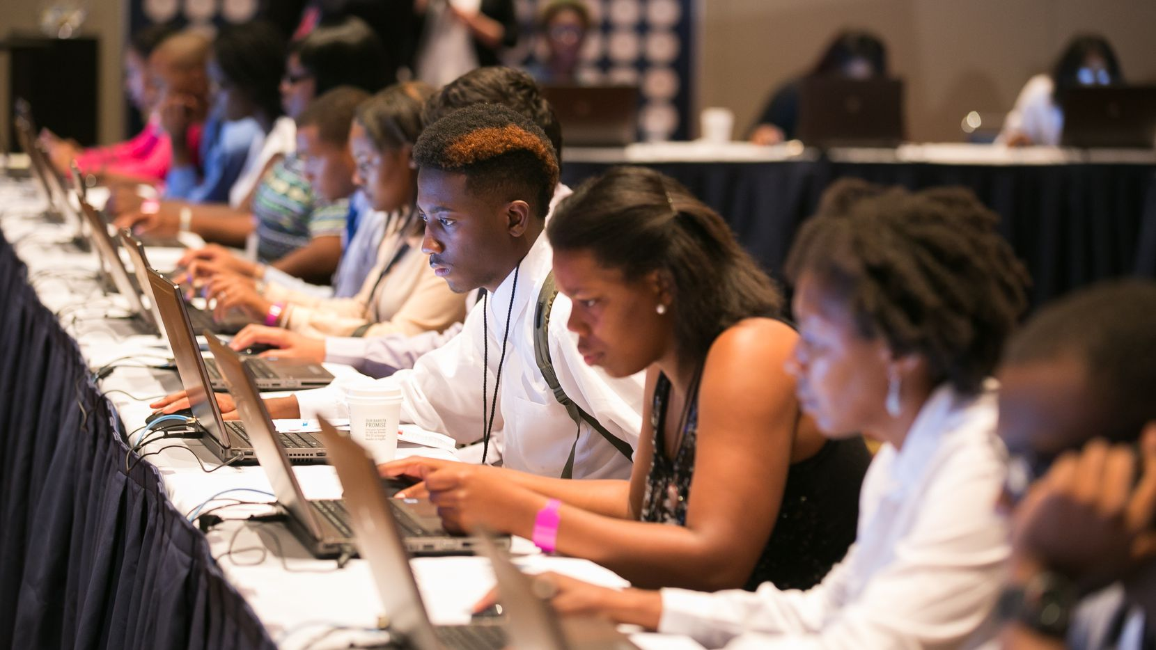 Youth filling out job applications at Opportunity Fair and Forum at McCormick Place Chicago, Ill. Thursday, August 13, 2015.  (Photo by Peter Wynn Thompson/AP Images for 100,000 Opportunities Initiative)