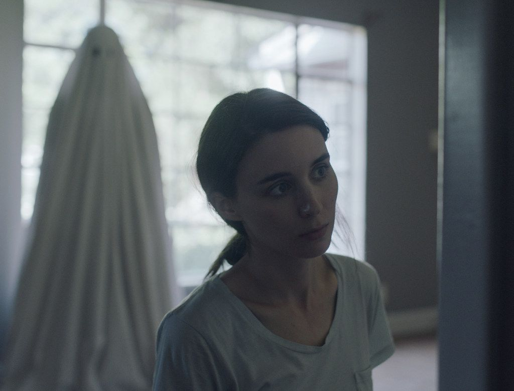 "This image released by A24 shows Rooney Mara in a scene from the film, ""A Ghost Story."" (Bret Curry/A24 via AP)"