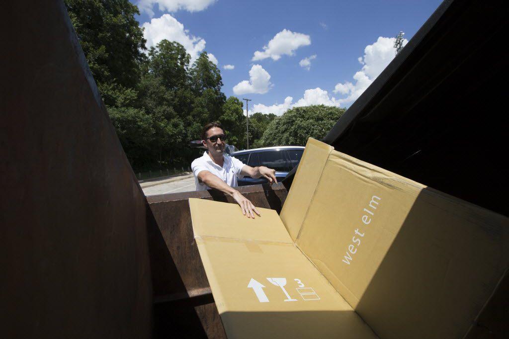 José Cavazos of Dallas tosses recyclable waste into a Dallas Sanitation Services Department community recycling container at the Reverchon Park location in 2016 in Dallas.