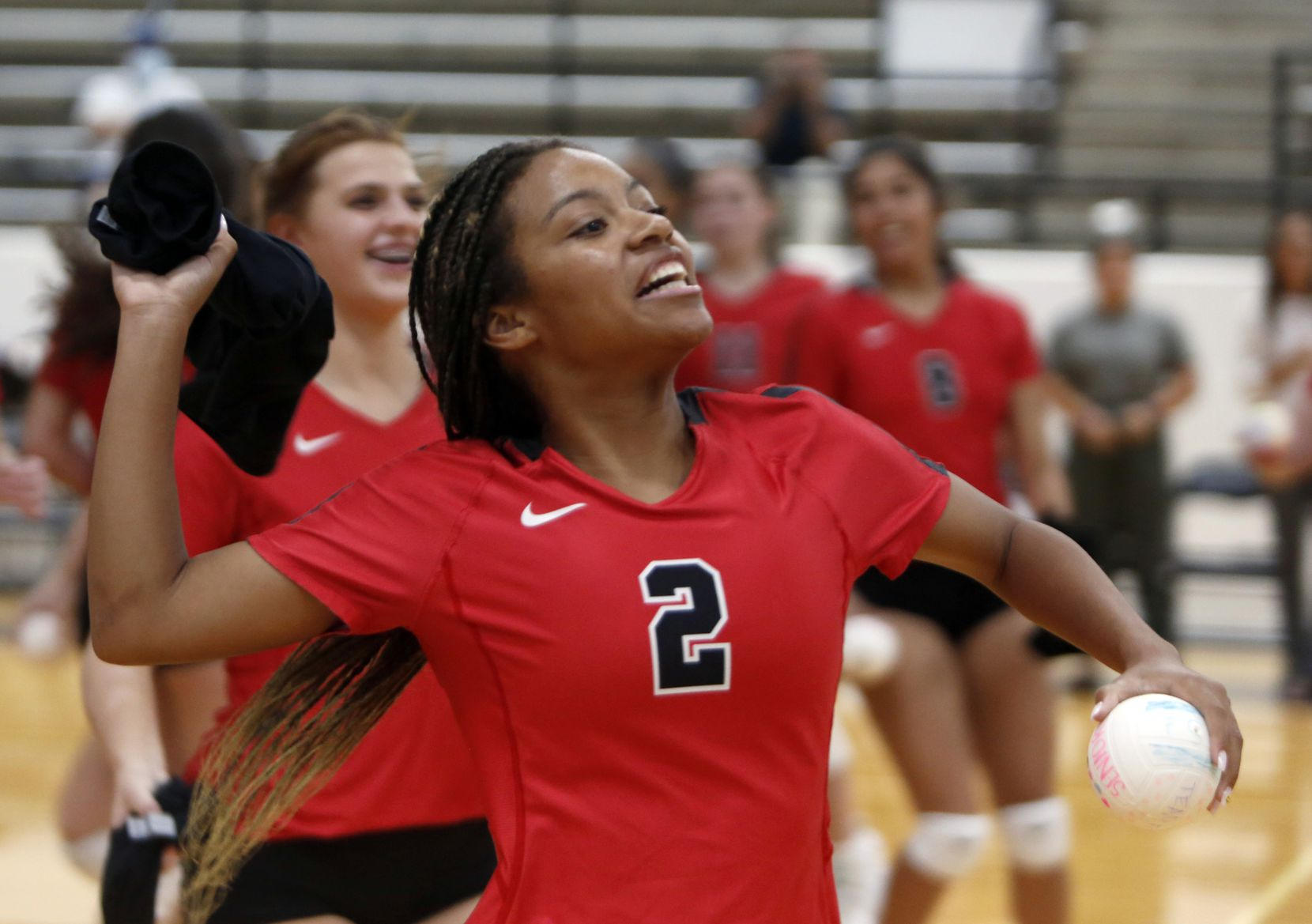 Arlington Martin's Aubrey Wright (2) prepares to launch a t-shirt into the crowd following team introductions prior to the start of their match against South Grand Prairie. Martin won in straight sets. The two teams played their volleyball match at Arlington Martin High School in Arlington on September 14, 2021. (Steve Hamm/ Special Contributor)
