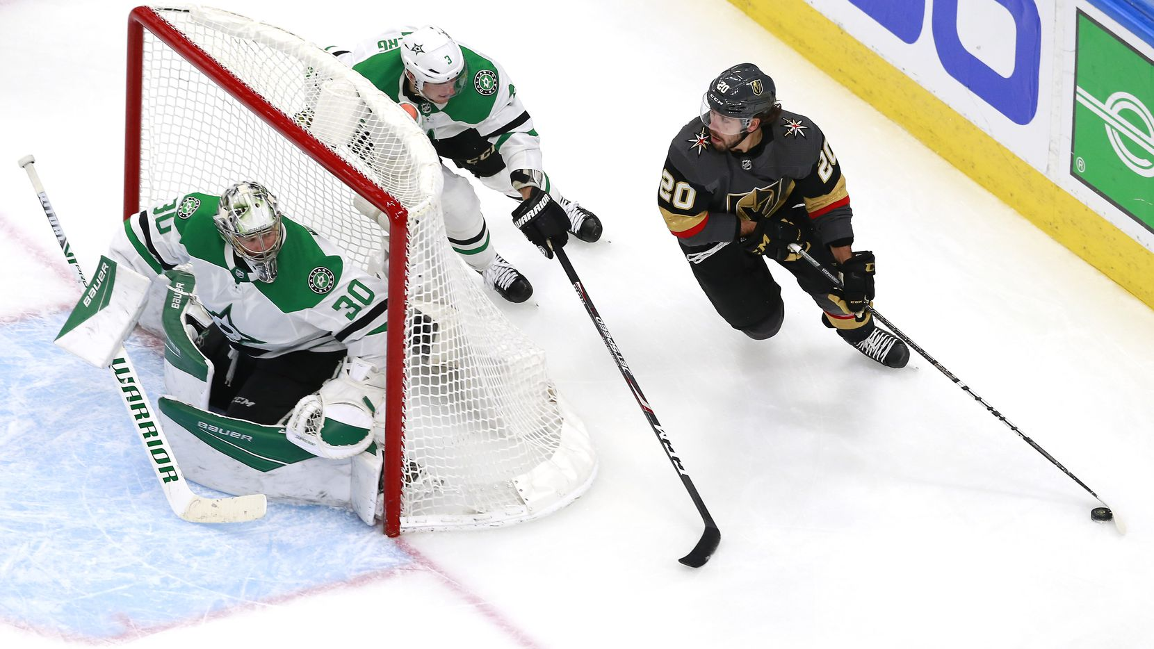 EDMONTON, ALBERTA - AUGUST 03:  Chandler Stephenson #20 of the Vegas Golden Knights wraps around the net as John Klingberg #3 and Ben Bishop #30 of the Dallas Stars defend in the third period in a Western Conference Round Robin game during the 2020 NHL Stanley Cup Playoff at Rogers Place on August 03, 2020 in Edmonton, Alberta.