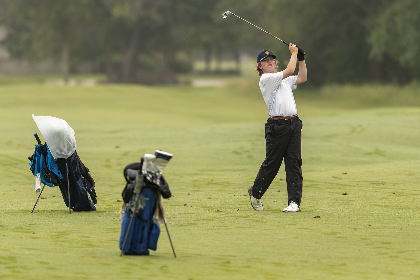 Highland ParkÕs Thompson Huthnance hits from the 12th fairway during round 1 of the UIL Class 5A boys golf tournament in Georgetown, Monday, May 17, 2021. (Stephen Spillman/Special Contributor)