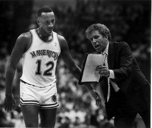 FILE - Dallas Mavericks coach John MacLeod (right) shows Derek Harper a new play.