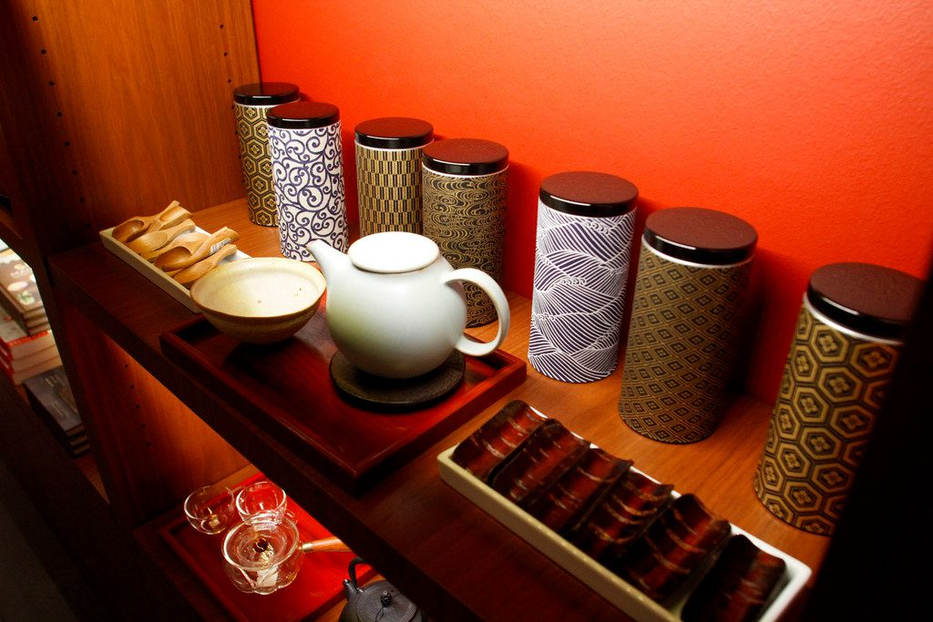 Shelf of dishes for sale in The Lotus Shop gift shop at the Crow Museum of Asian Art