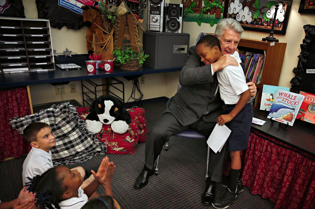 Pastor Jack Graham hugs Matthew Jordan after the 7-year-old handed him a hand-drawn anniversary card in May 2014 at Prestonwood Christian Academy in Plano. Graham is celebrating his 25th year as the head pastor of the church, which boasts a congregation of more than 37,000.