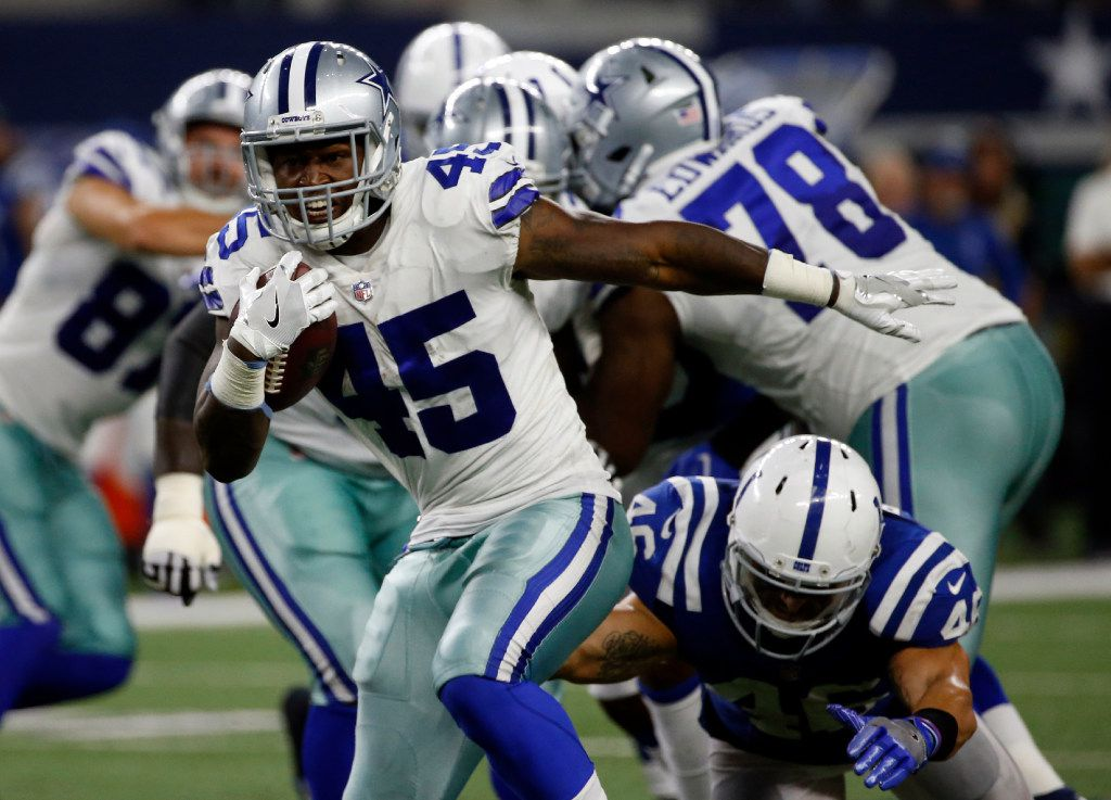 Dallas Cowboys fullback Rod Smith (45) breaks a tackle attempt by Indianapolis Colts linebacker Luke Rhodes (46) in the second half of a preseason NFL football game, Saturday, Aug. 19, 2017, in Arlington, Texas. (AP Photo/Ron Jenkins)