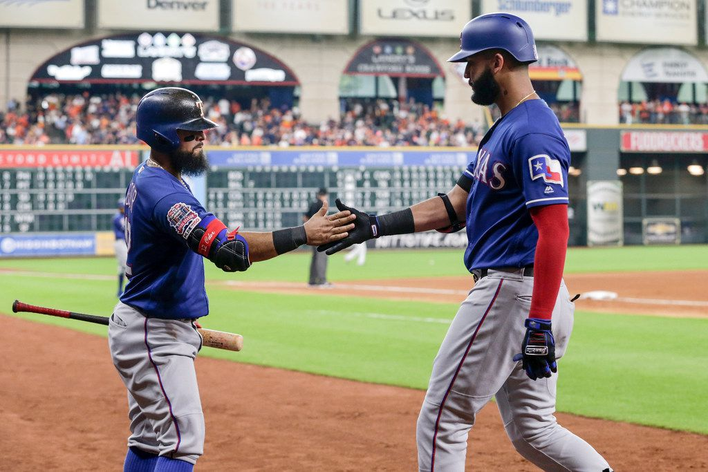 HOUSTON, TX - JULY 21:  Rougned Odor #12 of the Texas Rangers congratulates Nomar Mazara #30 after a home run in the sixth inning against the Houston Astros at Minute Maid Park on July 21, 2019 in Houston, Texas.  (Photo by Tim Warner/Getty Images)