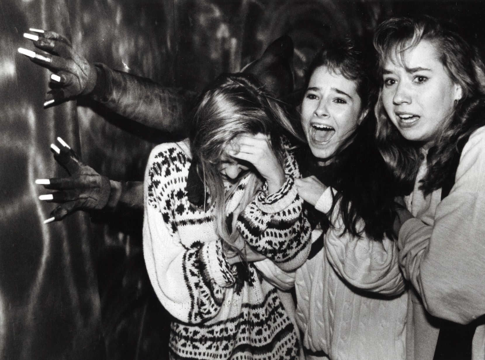 Sixteen-year-olds Natalie Monzingo, Kristina Hughes and Lora Moss scream as they walk through the March of Dimes Haunted House on Oct.  21, 1988.