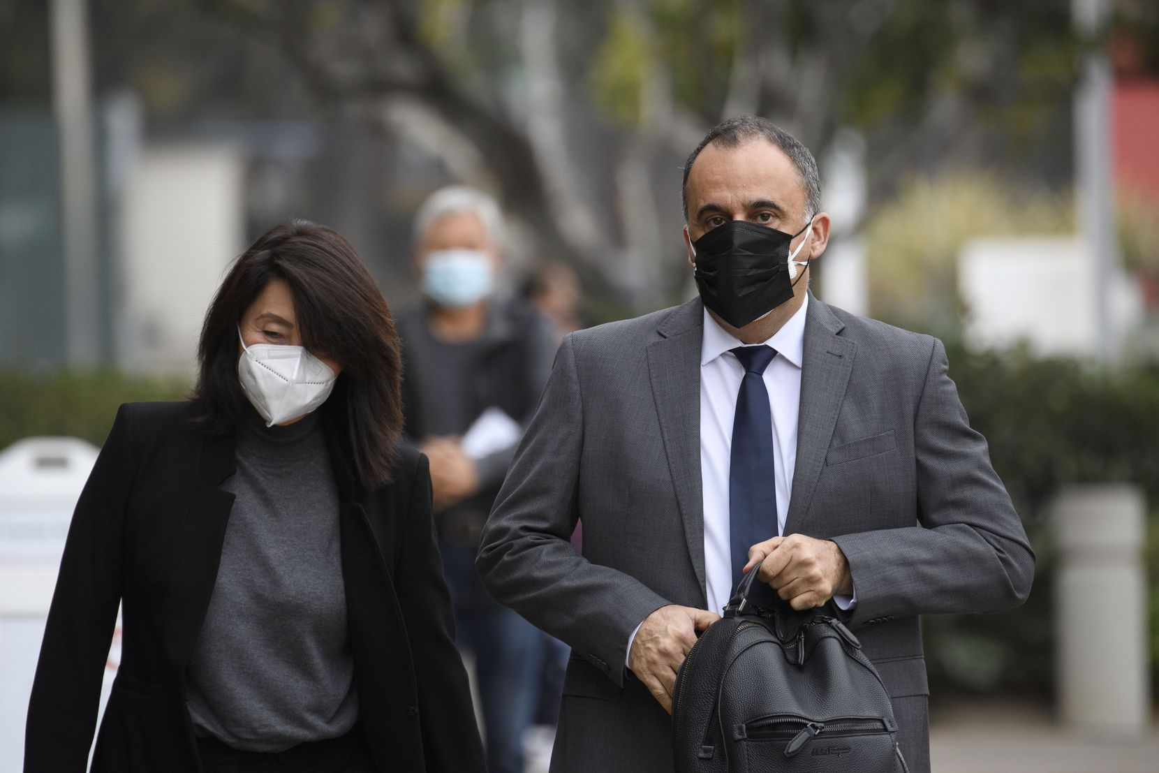 Mark Towfiq and his wife Carol Nakahara arrive for a court hearing in Santa Ana, Calif., on Dec. 7. Towfiq and Nakahara sued neighbors Bill Gross and Amy Schwartz.