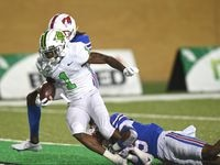 North Texas wide receiver Jaelon Darden (1) drags SMU defensive back Ar'mani Johnson (5) into the end zone for a touchdown in the fourth quarter of a game at Apogee Stadium on Saturday, Sept. 19, 2020, in Denton. (Photo by Al Key/DRC)
