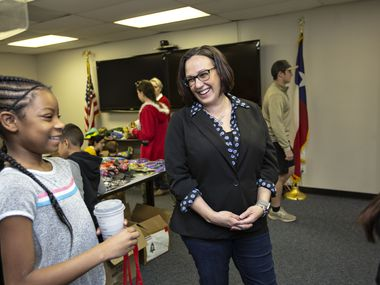 MJ Hegar chats with Azaria Jordan, 9, and her stepmother, Staff Sgt. Selina Robinson during her visit Operation Homefront's toy distribution event at the Army base in Austin. (Thao Nguyen/Special Contributor)