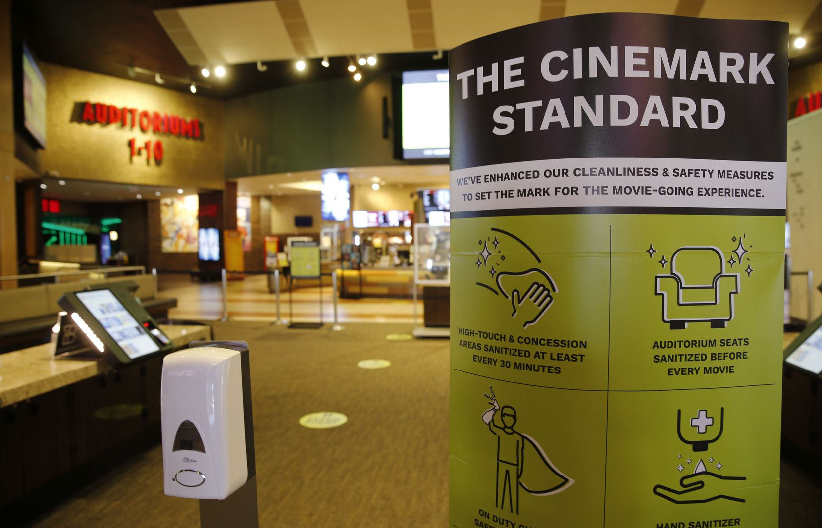 Signage noting new cleanliness and safety measures at Cinemark West in Plano, on Thursday. The theater reopened on Friday.