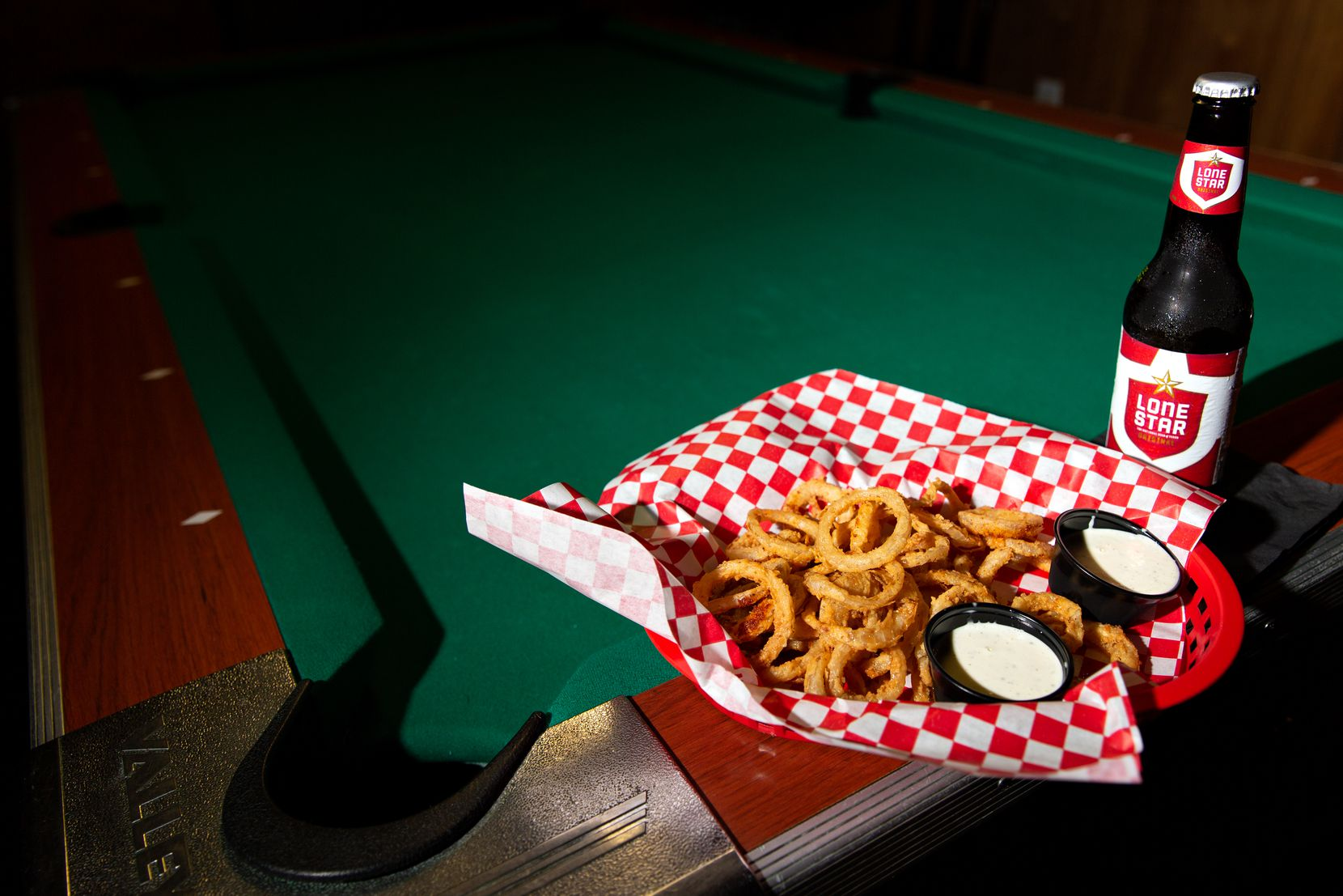 At Lakewood Landing in Dallas, you can pair a round of pool with some Noonday onion rings, which are famously some of the sweetest onions available in the U.S.