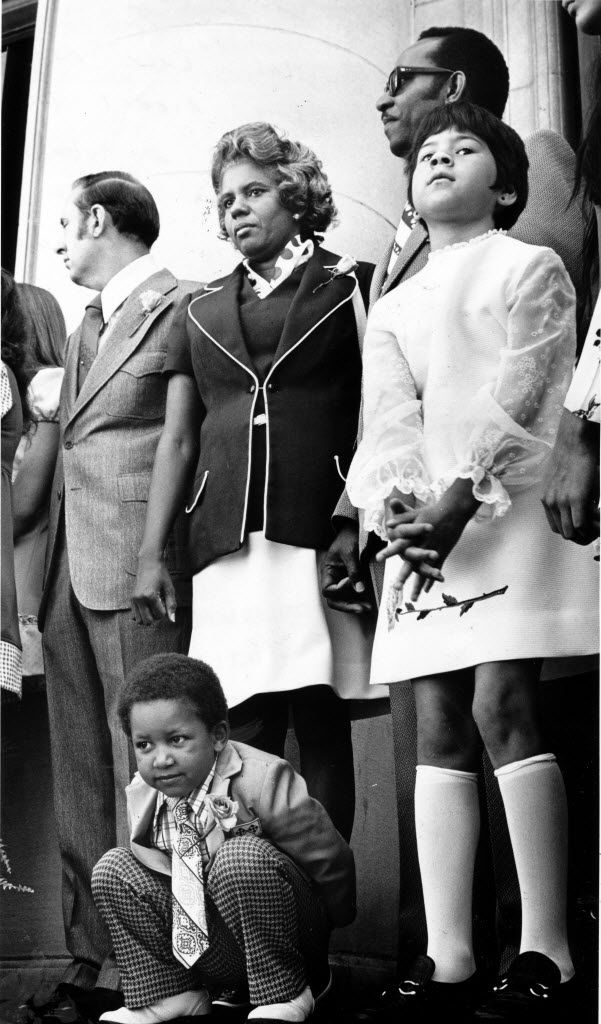 Lucy Patterson (center) at swearing-in ceremonies for Dallas City Council members on the steps of City Hall on May 7, 1973. Kneeling in front of Patterson is her son, Albert, age 3.