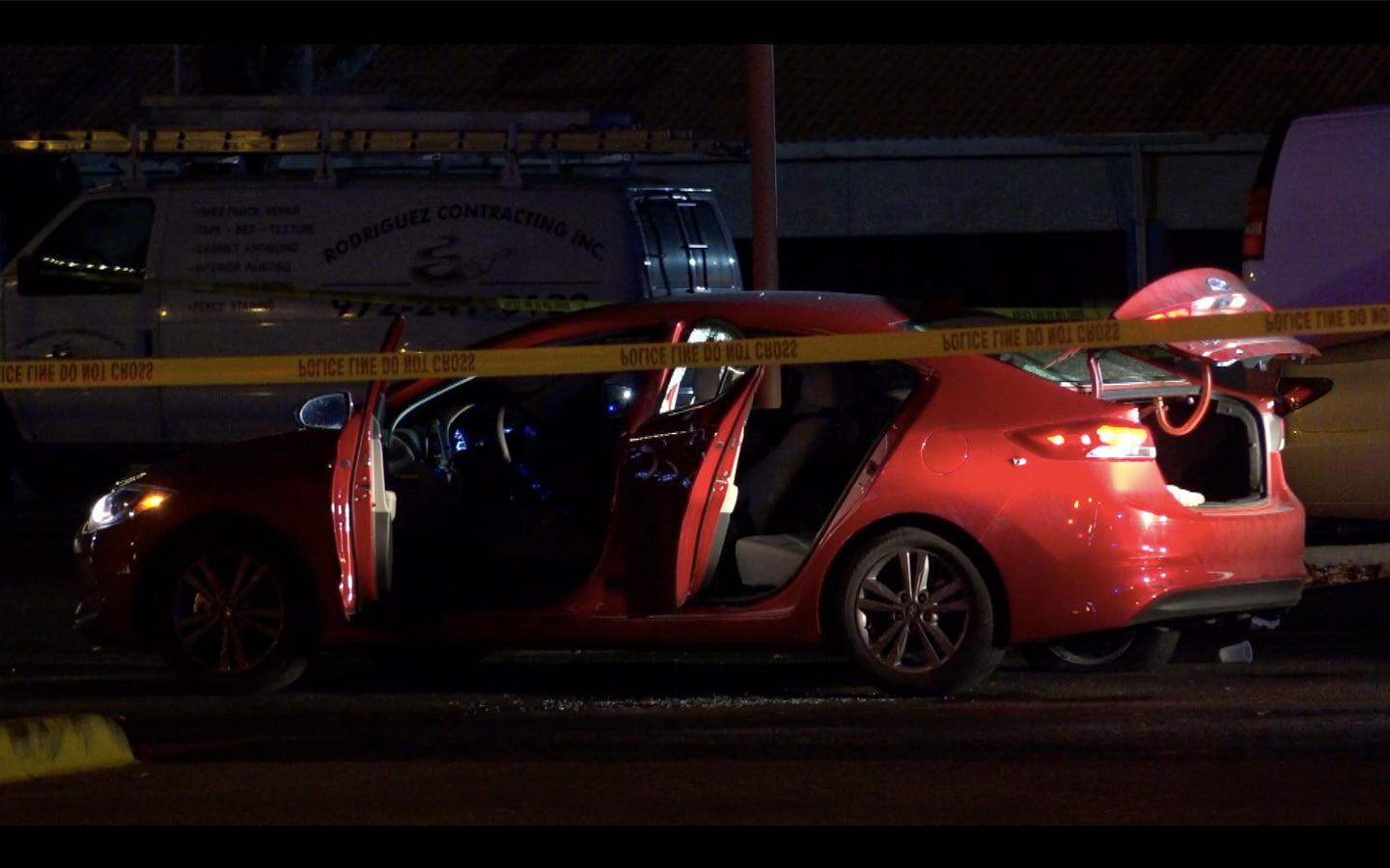 A shootout between a Farmers Branch police officer and a female passenger took place after this car was pulled over late Tuesday  on Valley View Lane.