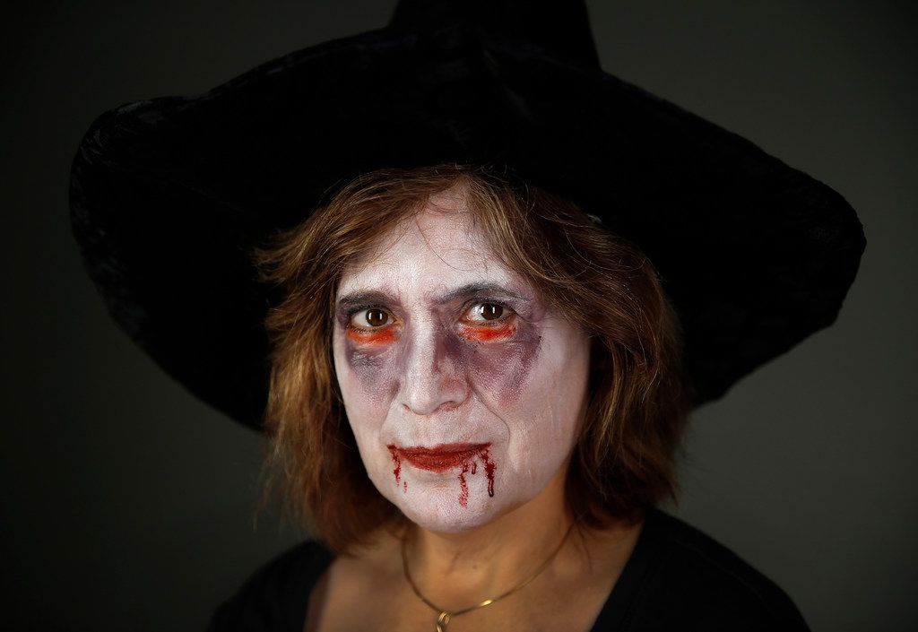 Dallas Children's Theater make-up artist Doug Burks transformed Nancy Churnin into a ghoul at the studio in Dallas on Oct. 5.