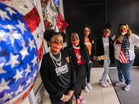 (From left) Shanna Austin, Principal Rockell Stewart, Camila Saavedra, Tiambra Hunt and Campus Coordinator Vonda Pipkin pose for a photo at Billy Earl Dade Middle School in Dallas on Inauguration Day, Wednesday, Jan. 20, 2021. Students and staff at the school wore Chucks and pearls to to celebrate Kamala Harris, the first woman of color, being sworn in as vice president. (Juan Figueroa/ The Dallas Morning News)