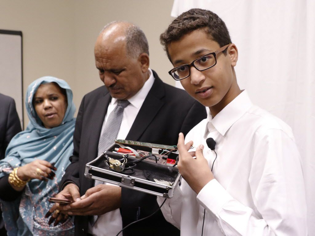 Ahmed Mohamed, with his parents, Muna Ibrahim and Mohamed Elhassan Mohamed, shows the clock he built in a school pencil box that led to an interrogation and his arrest last year.  In a news conference Monday, the family's attorneys announced they had filed a federal lawsuit against Texas school officials and others, saying they violated the 14-year-old boy's civil rights.