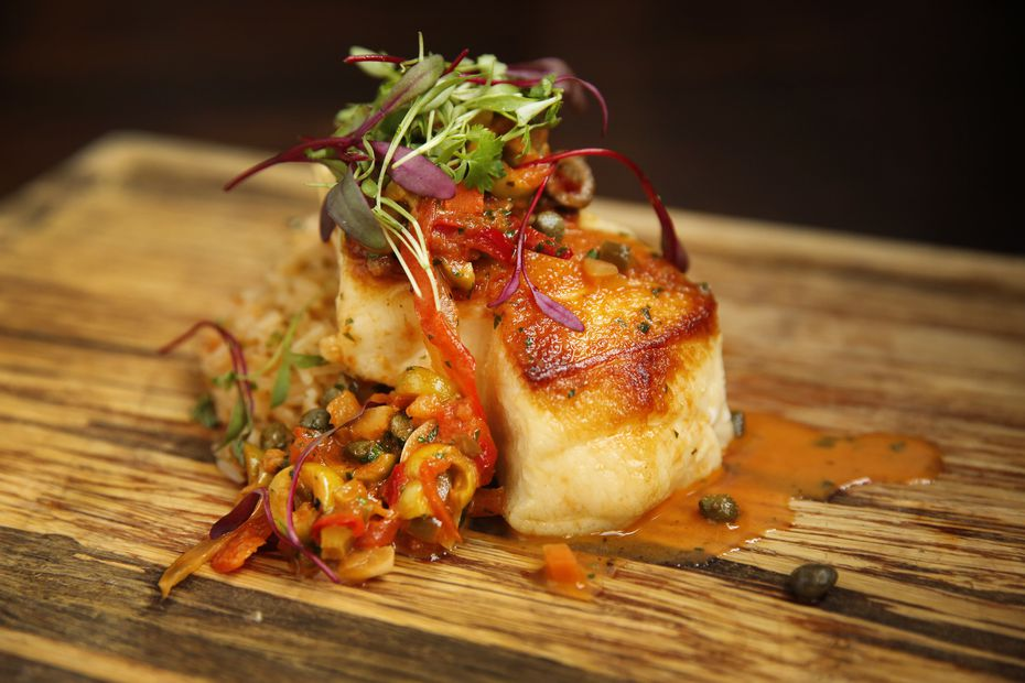 The menu is more upscale at Primo's Mx Kitchen & Lounge when compared to the original Primo's. Sea Bass Veracruz is one of the dishes marked under 'specialties.'