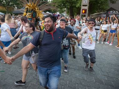 Celebrants dance during a Pride block party sponsored by the Dallas Arts District.