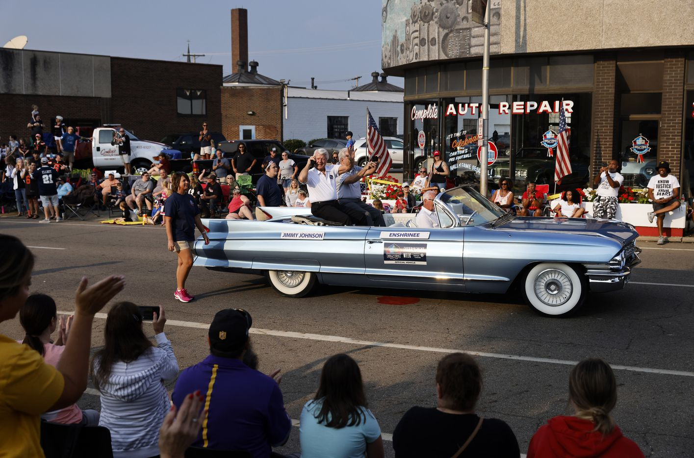 Dallas Cowboys head coach and Pro Football Hall of Fame inductee Jimmy Johnson waves to fans in the Canton Repository Grand Parade as he rides in a classic convertible car in downtown Canton, Ohio, Saturday, August 7, 2021. The parade honored newly elected and former members of the Hall, including newcomers and former Dallas Cowboys players Cliff Harris, Drew Pearson and head coach Jimmy Johnson. (Tom Fox/The Dallas Morning News)
