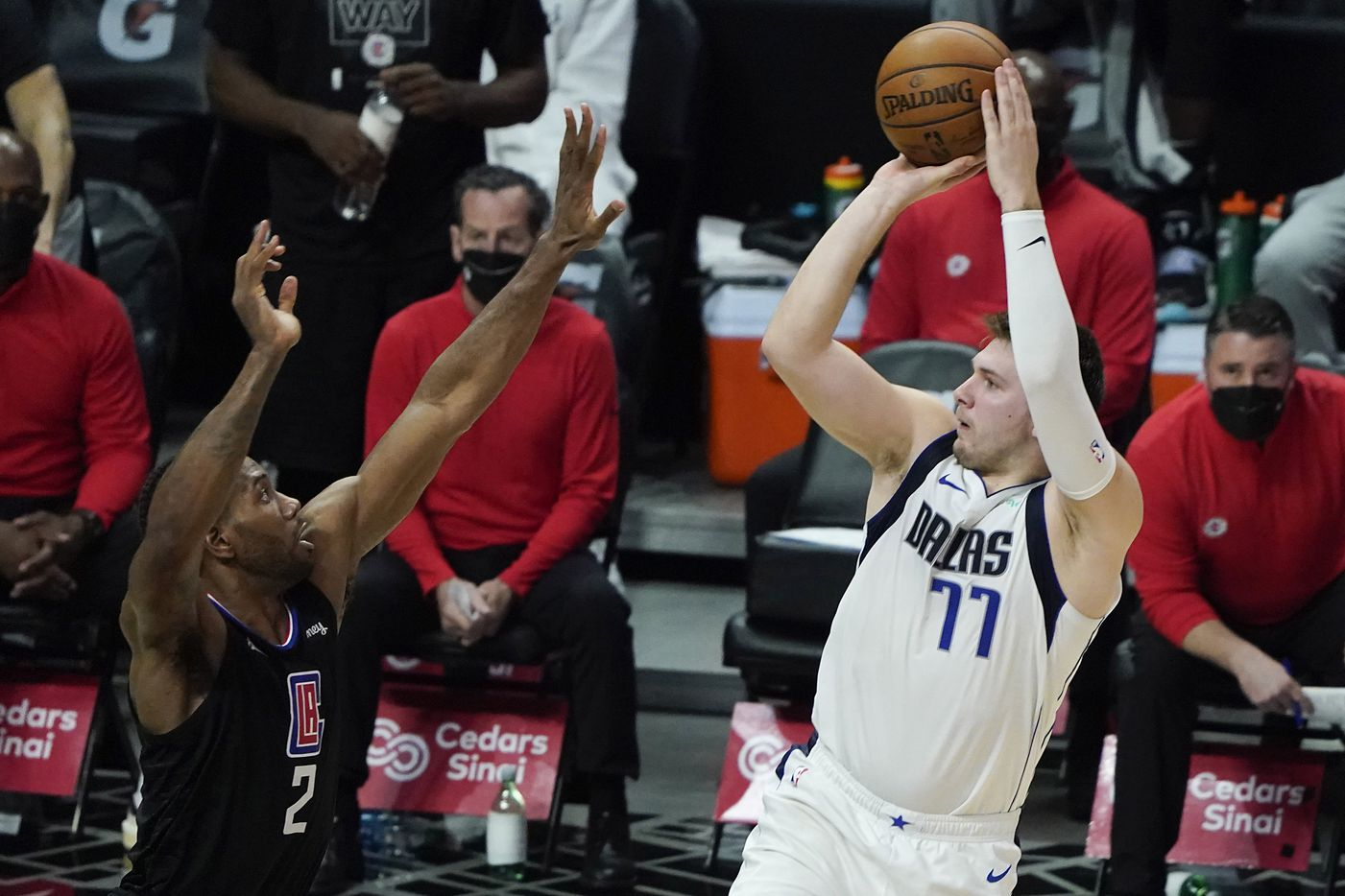 Dallas Mavericks guard Luka Doncic (77) shoots over LA Clippers forward Kawhi Leonard (2) during the second half of an NBA playoff basketball game at Staples Center on Tuesday, May 25, 2021, in Los Angeles.