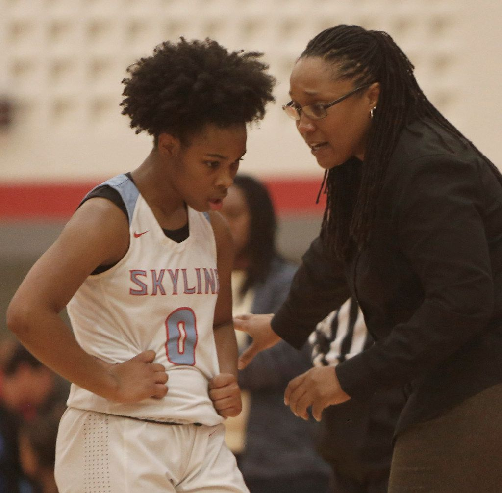 Dallas Skyline head coach Melonie Hopson speaks with Zyniah Thomas (0) in front of the team bench during first half action against Duncanville. The two teams played their girls basketball game at  Skyline High School in Dallas on January 7, 2020. (Steve Hamm/ Special Contributor)