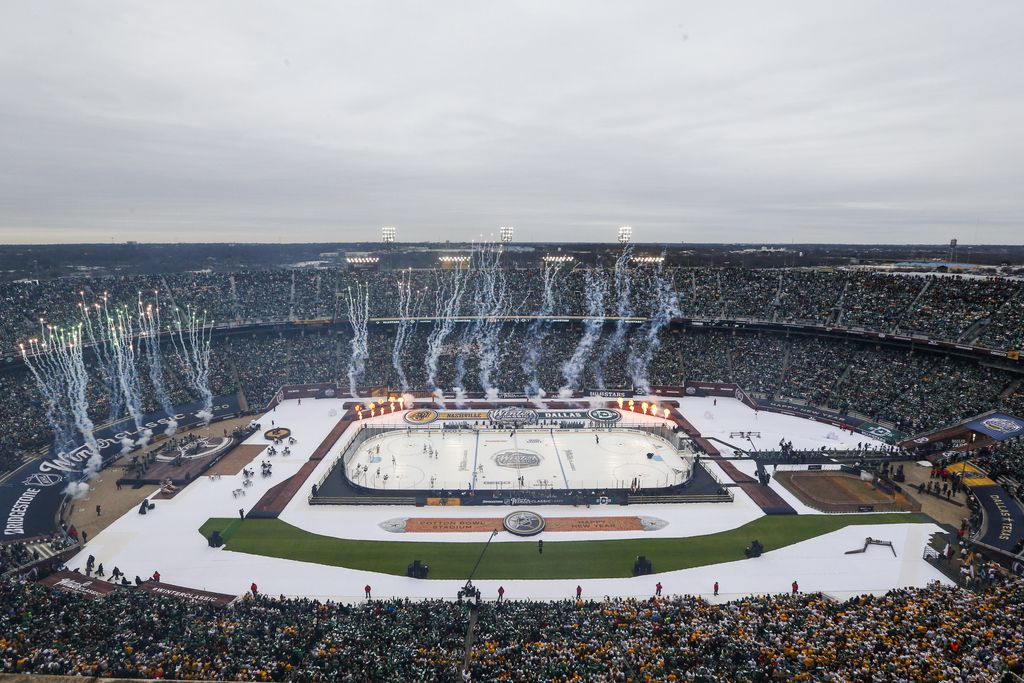 Pyrotechnics go off prior to the first period of a NHL Winter Classic matchup between the Dallas Stars and the Nashville Predators on Wednesday, January 1, 2020 at Cotton Bowl Stadium in Dallas. (Ryan Michalesko/The Dallas Morning News)