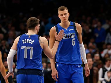 FILE - Mavericks guard Luka Doncic (77) and forward Kristaps Porzingis (6) are pictured during overtime of a game against the Pelicans on March 4, 2020, at American Airlines Center in Dallas.