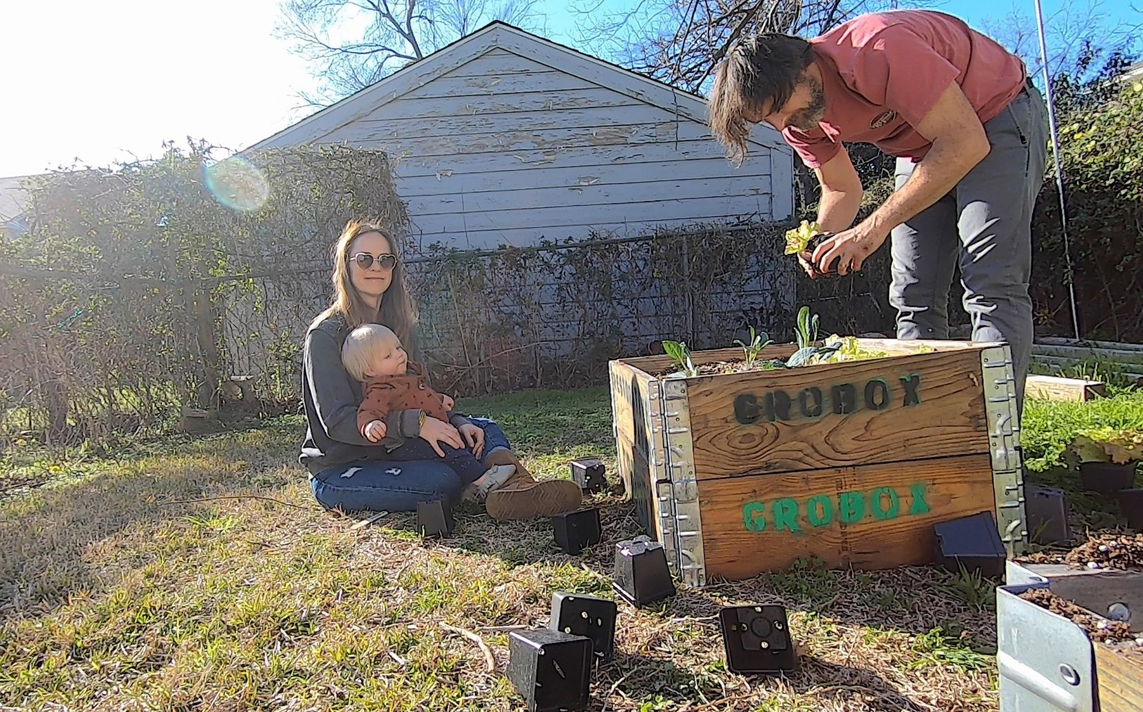 Rick Baraff and Courtney Miles Baraff plant GroBox gardens with their our 17-month old twins, Clyde and Edie