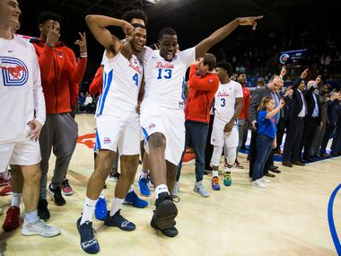 Southern Methodist Mustangs guard Charles Smith IV (4) and guard CJ White (13) celebrate a 73-72 overtime win after a basketball game between SMU and University of Houston on Saturday, February 15, 2020 at Moody Coliseum in Dallas.